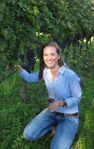 Karoline Walch in her family's Merlot vines in Alto Adige. (photo by Hayley Hamilton Cogill)